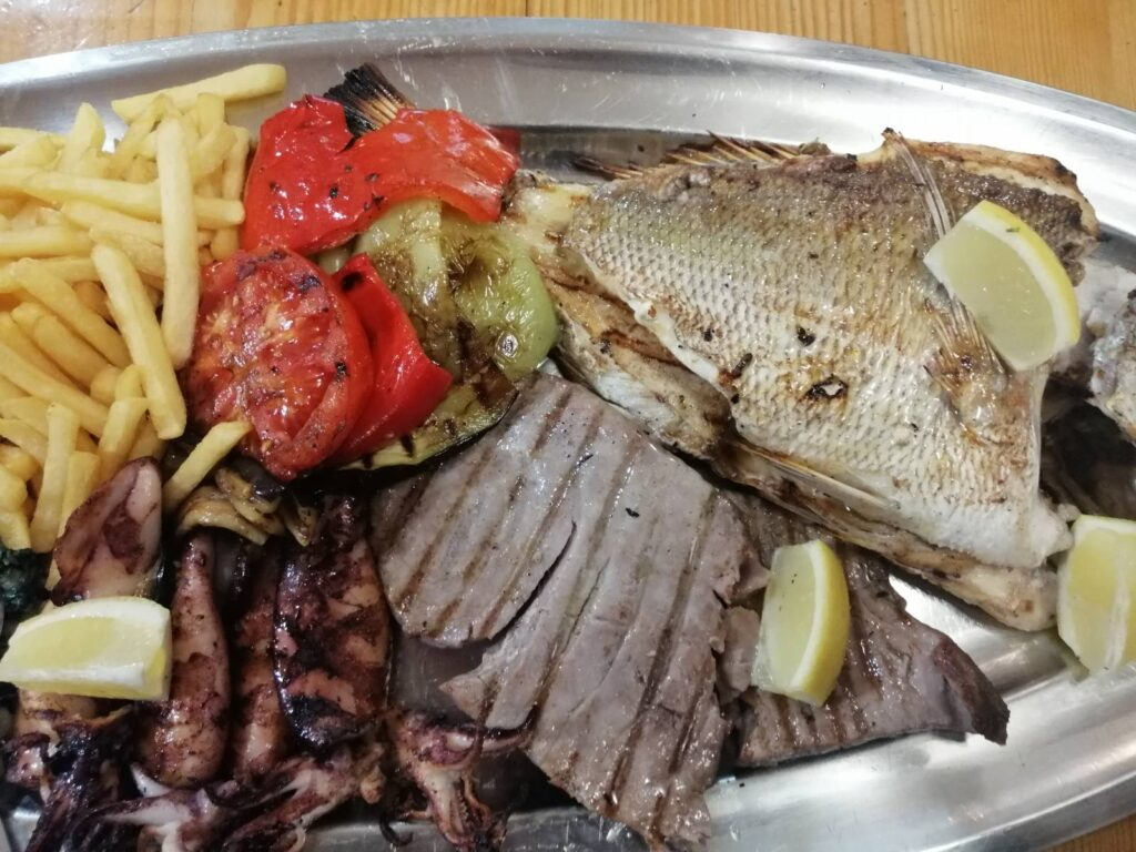 grilled tuna steak fish calamari vegetables